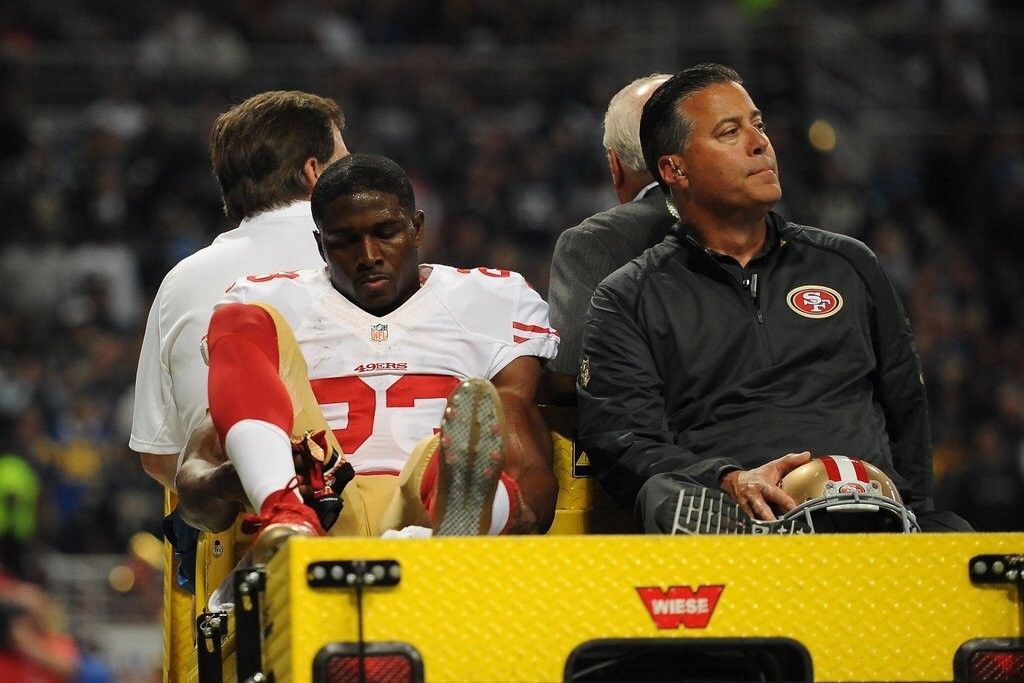 49ers running back Reggie Bush injured his ACL slipping on the concrete