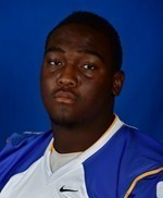 Defensive Tackle Shakore Philip is a big boy with a good motor